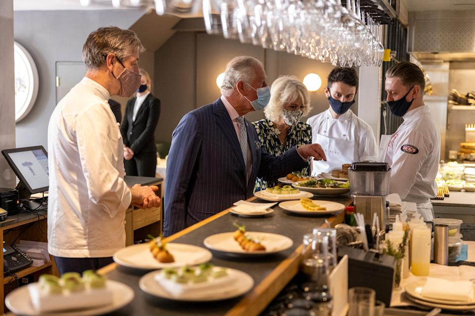 Britain's Prince Charles, Prince of Wales and Britain's Camilla, Duchess of Cornwall visit Trinity Restaurant Clapham during their visit to Clapham Old Town, south London on May 27, 2021. (Photo by Heathcliff O'Malley / POOL / AFP) (Photo by HEATHCLIFF O'MALLEY/POOL/AFP via Getty Images)