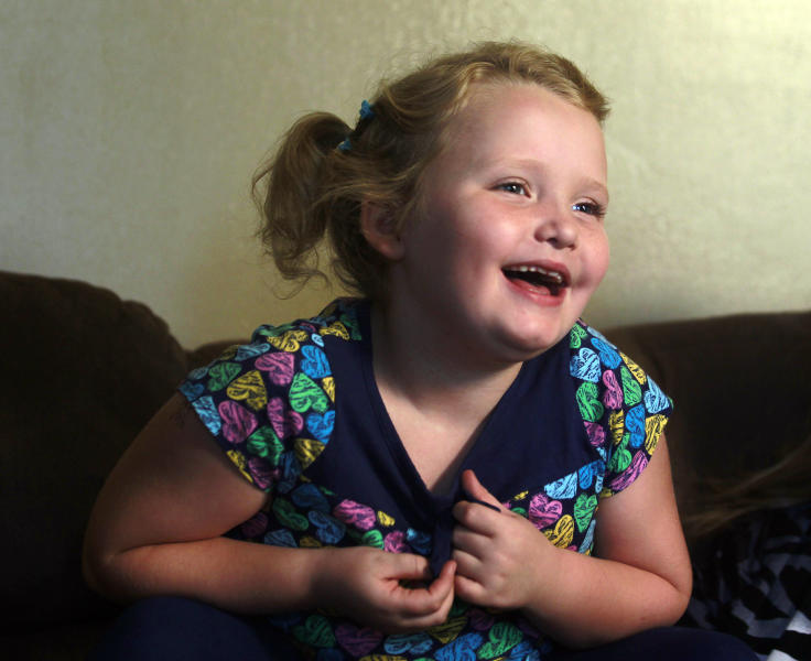 """In this photo taken Monday, Sept. 10, 2012, seven-year-old beauty pageant regular and reality show star Alana """"Honey Boo Boo"""" Thompson gestures during an interview in her home in McIntyre, Ga. The reality show """"Here Comes Honey Boo Boo"""" has been a ratings winner in recent weeks, capitalizing on redneck stereotypes and the oversized personality of Thompson. (AP Photo/John Bazemore)"""