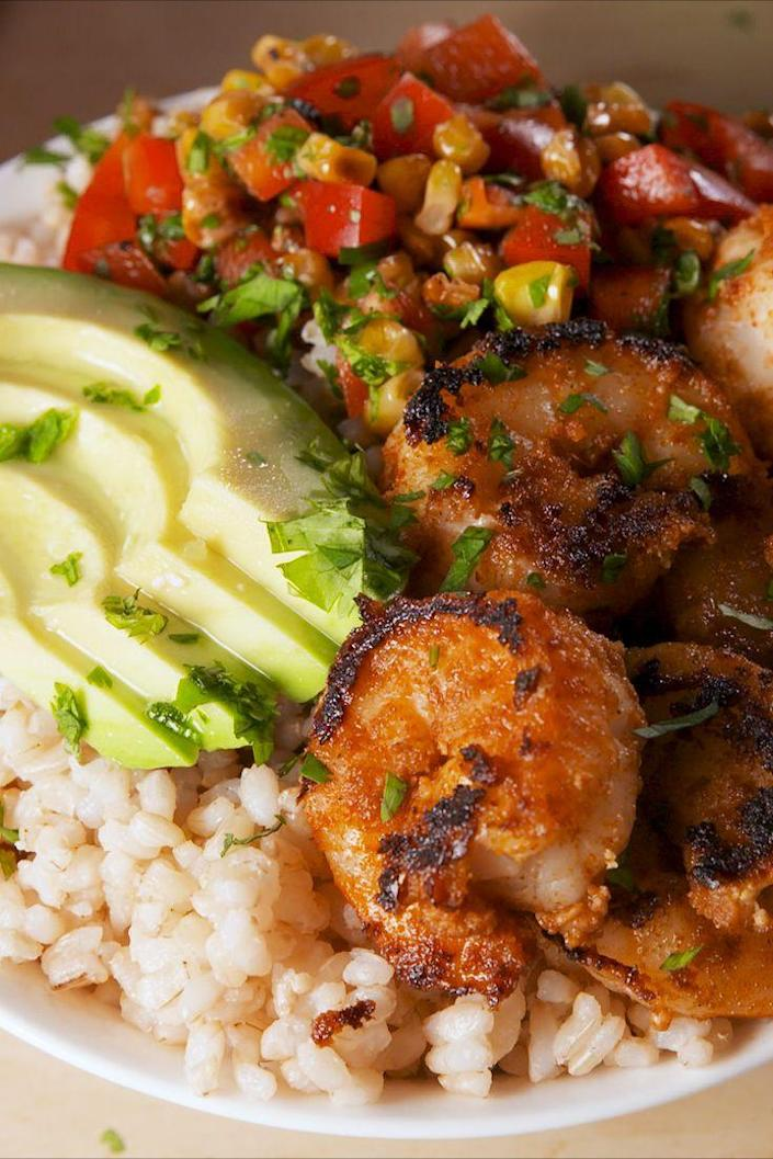 "<p>Protein, whole grain, fresh veg--we've got you covered.</p><p>Get the recipe from <a href=""https://www.delish.com/cooking/recipe-ideas/a19624080/blackened-shrimp-bowls-recipe/"" rel=""nofollow noopener"" target=""_blank"" data-ylk=""slk:Delish"" class=""link rapid-noclick-resp"">Delish</a>.</p>"