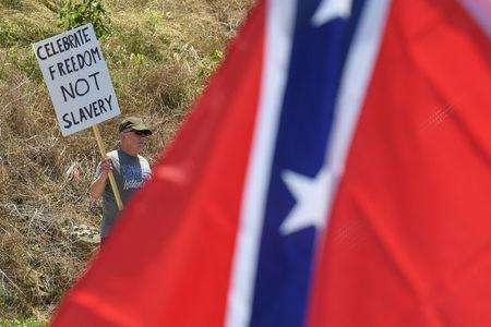 A man protests during a dedication ceremony for a Civil War Confederate Soldier Memorial in Brandenburg, Kentucky, U.S. May 29, 2017. The memorial was recently removed from the campus of the University of Louisville. REUTERS/Bryan Woolston