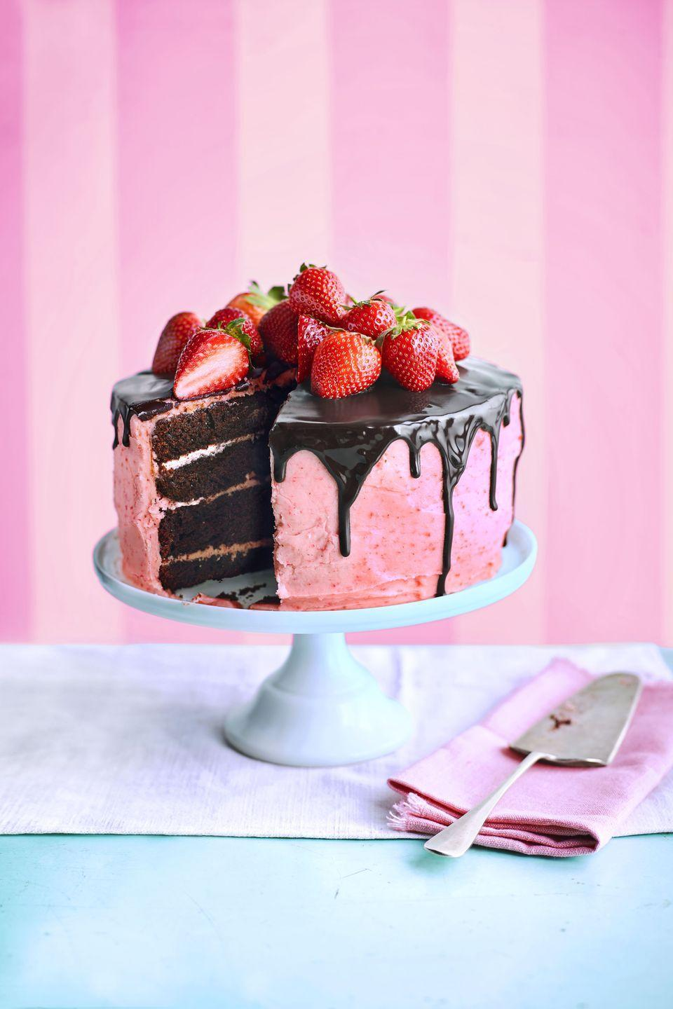 """<p>Turn an iconic combo into a celebration-worthy centerpiece.</p><p><a href=""""https://www.womansday.com/food-recipes/a36502165/choco-berry-surprise-cake-recipe/"""" rel=""""nofollow noopener"""" target=""""_blank"""" data-ylk=""""slk:Get the recipe for Choco-Berry Surprise Cake."""" class=""""link rapid-noclick-resp""""><em>Get the recipe for Choco-Berry Surprise Cake.</em></a></p>"""