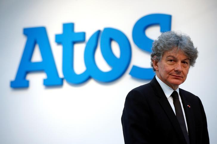 FILE PHOTO - Atos Chairman and CEO Thierry Breton poses in front of the company's logo during a presentationin Paris