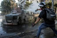 Riot police deployed armored water cannons to disperse the Santiago demonstrators