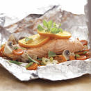 """<p>Clean up is a breeze with this recipe. Put the salmon and vegetables in a foil packet, then cook. Toss the foil after dinner and you're done. <a href=""""http://www.eatingwell.com/recipe/265134/salmon-vegetable-bake/"""" rel=""""nofollow noopener"""" target=""""_blank"""" data-ylk=""""slk:View recipe"""" class=""""link rapid-noclick-resp""""> View recipe </a></p>"""