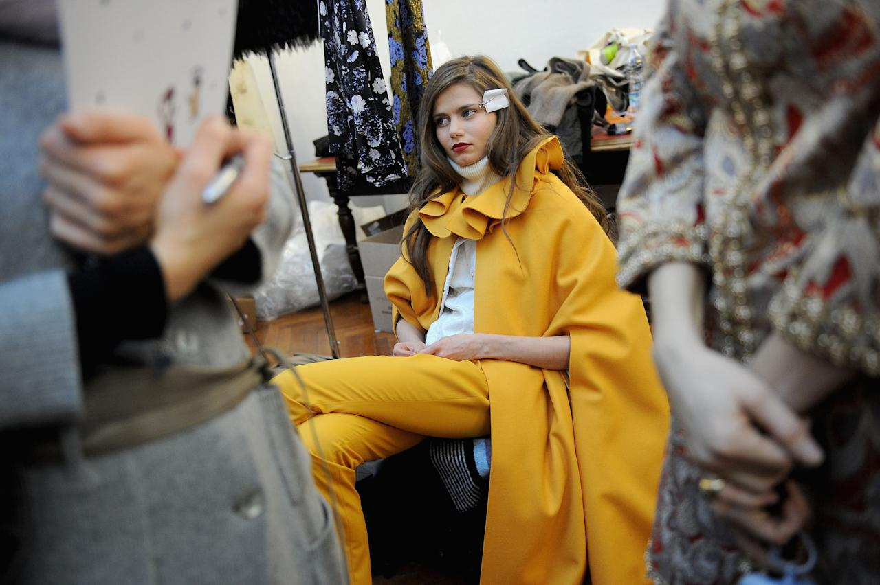 MILAN, ITALY - FEBRUARY 27: A model prepares backstage the Normaluisa Autumn/Winter 2012/2013 fashion show as part of Milan Womenswear Fashion Week on February 27, 2012 in Milan, Italy.  (Photo by Tullio M. Puglia/Getty Images)