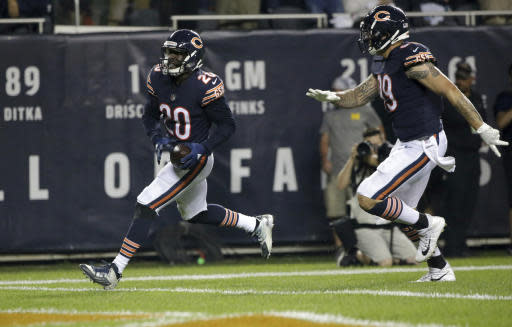 Chicago Bears defensive back Prince Amukamara (20) runs to the end zone for a touchdown after intercepting a pass intended for Seattle Seahawks running back Rashaad Penny during the second half of an NFL football game Monday, Sept. 17, 2018, in Chicago. (AP Photo/David Banks)