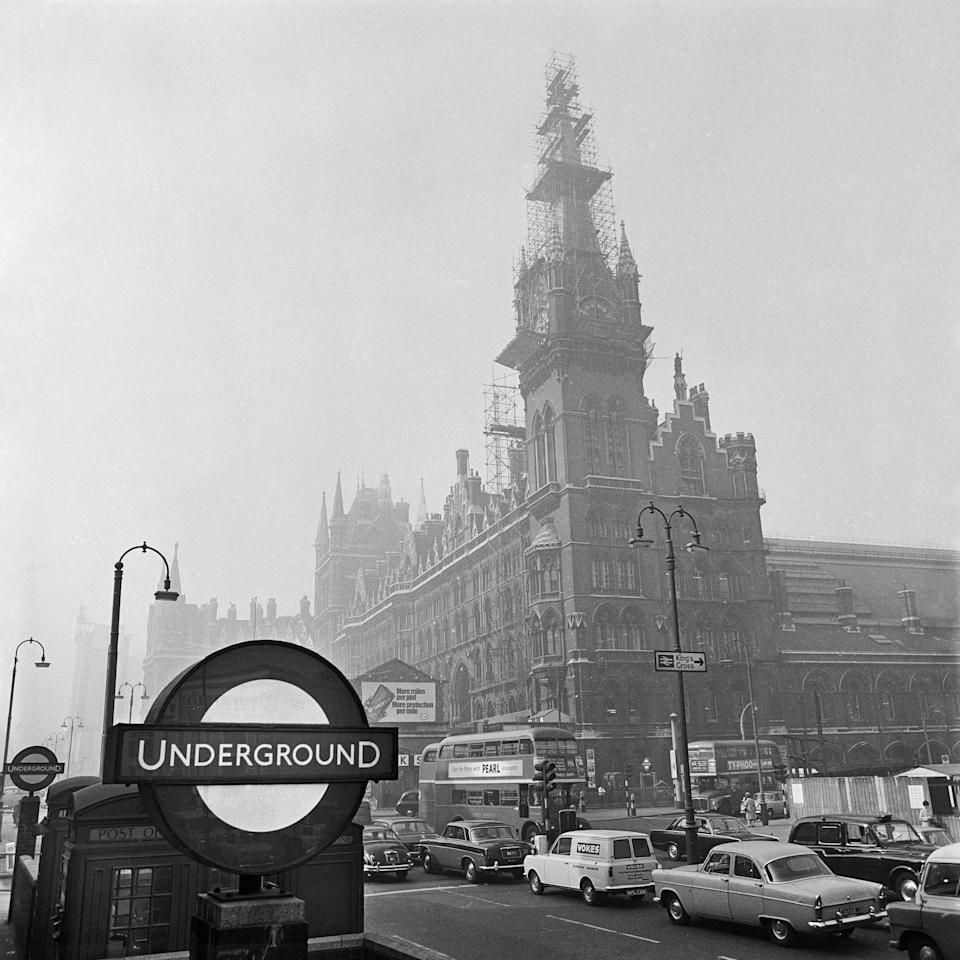 St Pancras Station, London, 1960-1972. View looking towards St Pancras Station from a busy Euston Road with the Underground sign in the foreground. The station clocktower is covered in scaffolding. (Photo by English Heritage/Heritage Images/Getty Images)  - Getty