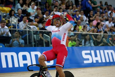 Cycling - UCI Track World Championships - Men's Sprint, Final - Hong Kong, China – 15/4/17 - Russia's Denis Dmitriev celebrates after winning gold. REUTERS/Bobby Yip