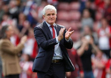 Southampton manager Mark Hughes applauds fans during a lap of appreciation after the match. Reuters/John Sibley