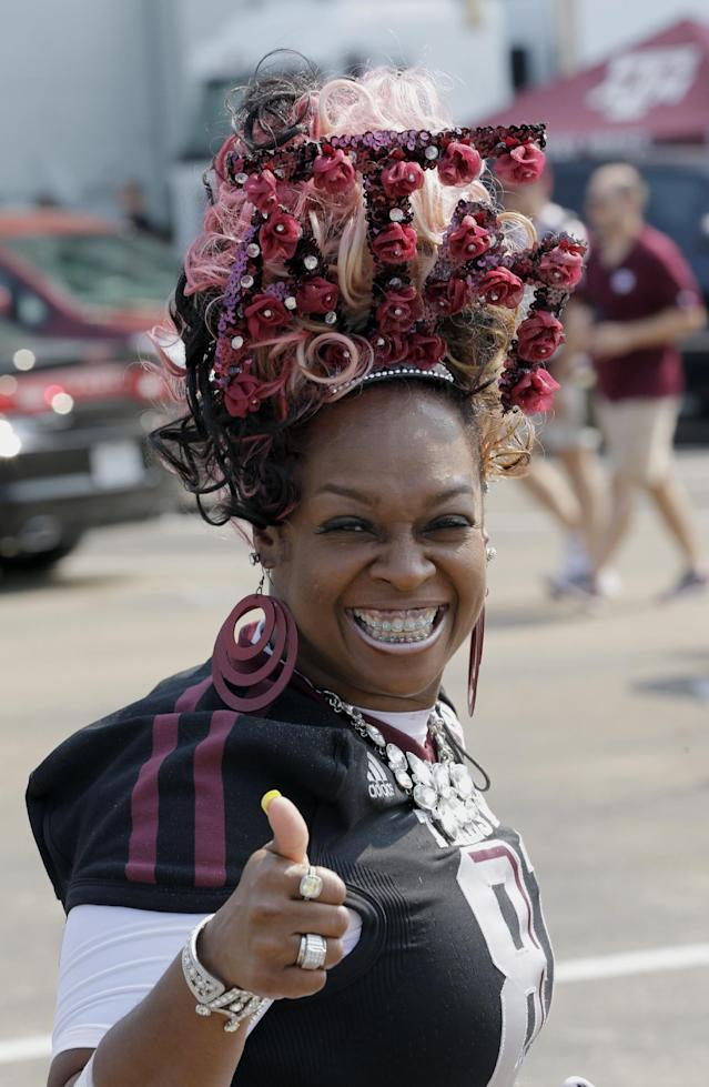 Rochelle Luttrall, mother of Texas A&M tight end Nehemiah Hicks, shows her support as she arrives at Kyle Filed for an NCAA college football game between Alabama and Texas A&M Saturday, Sept. 14, 2013, in College Station, Texas. (AP Photo/David J. Phillip)