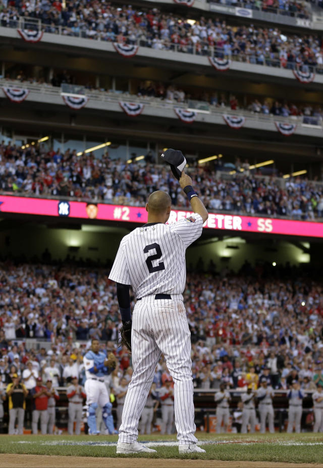 American League shortstop Derek Jeter, of the New York Yankees, waves as he is taken out of the game in the top of the fourth inning of the MLB All-Star baseball game, Tuesday, July 15, 2014, in Minneapolis. (AP Photo/Jeff Roberson)