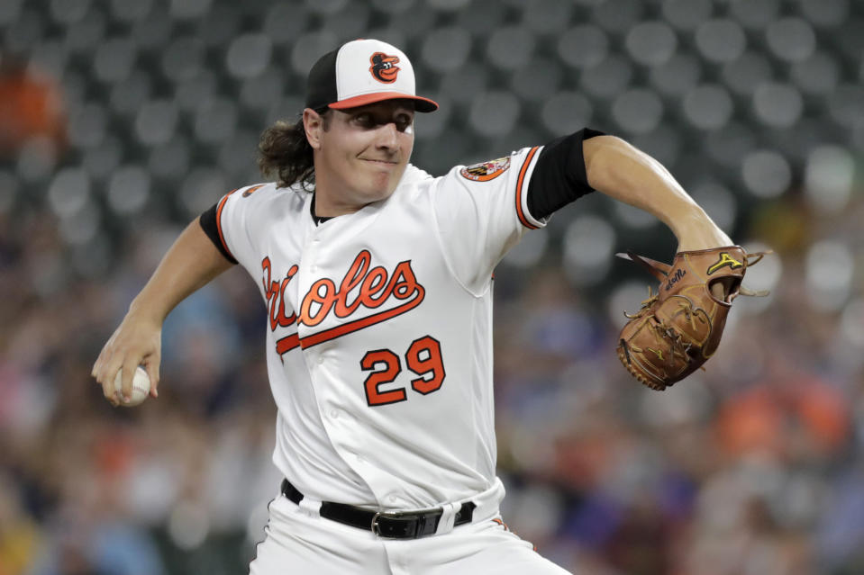 Baltimore Orioles starting pitcher Asher Wojciechowski throws to a New York Yankees batter during the first inning of a baseball game, Tuesday, Aug. 6, 2019, in Baltimore. (AP Photo/Julio Cortez)