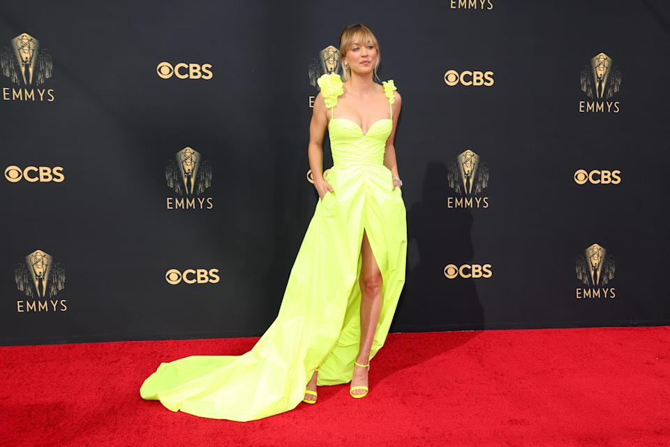 If the Emmys red carpet is any indication, neon is in. Kaley wore a lemon-lime Vera Wang gown with a slit and train.