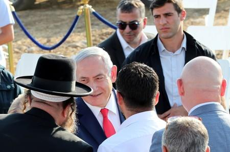 Israeli Prime Minister Benjamin Netanyahu attends a ceremony to unveil a sign for a new community named after U.S. President Donald Trump, in the Israeli-occupied Golan Heights