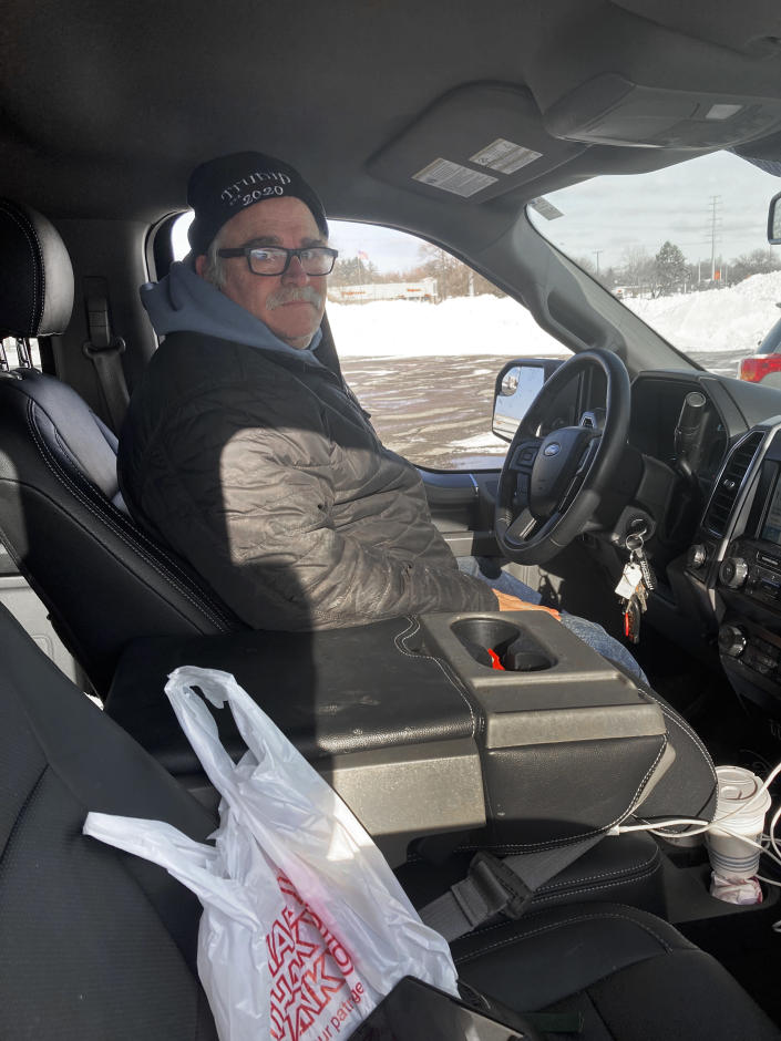 Larry Parsons, who bought a used pickup truck last year in part due to the high cost of new trucks, sits inside his Ford F-150 in Livonia, Mich., Tuesday, Feb. 16, 2021. A chain reaction touched off by the coronavirus pandemic has pushed new-vehicle prices to record highs and dramatically driven up the cost of used ones. (AP Photo/Mike Householder)