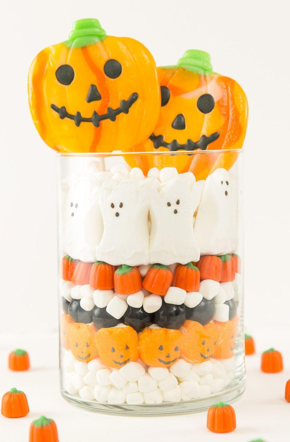 """<p>Put all that candy to good use by stacking the festive treats inside a clear container. <br></p><p><strong>Get the tutorial at <a href=""""http://www.lily-the-wandering-gypsy.com/new-blog/2015/10/20/a-halloween-party-with-skype"""" rel=""""nofollow noopener"""" target=""""_blank"""" data-ylk=""""slk:Lily the Wandering Gypsy"""" class=""""link rapid-noclick-resp"""">Lily the Wandering Gypsy</a>.</strong></p><p><a class=""""link rapid-noclick-resp"""" href=""""https://www.amazon.com/Royal-Imports-Decorative-Centerpiece-Cylinder/dp/B01MTKK8RN/?tag=syn-yahoo-20&ascsubtag=%5Bartid%7C10050.g.3739%5Bsrc%7Cyahoo-us"""" rel=""""nofollow noopener"""" target=""""_blank"""" data-ylk=""""slk:SHOP GLASS CYLINDER VASE"""">SHOP GLASS CYLINDER VASE</a> </p>"""