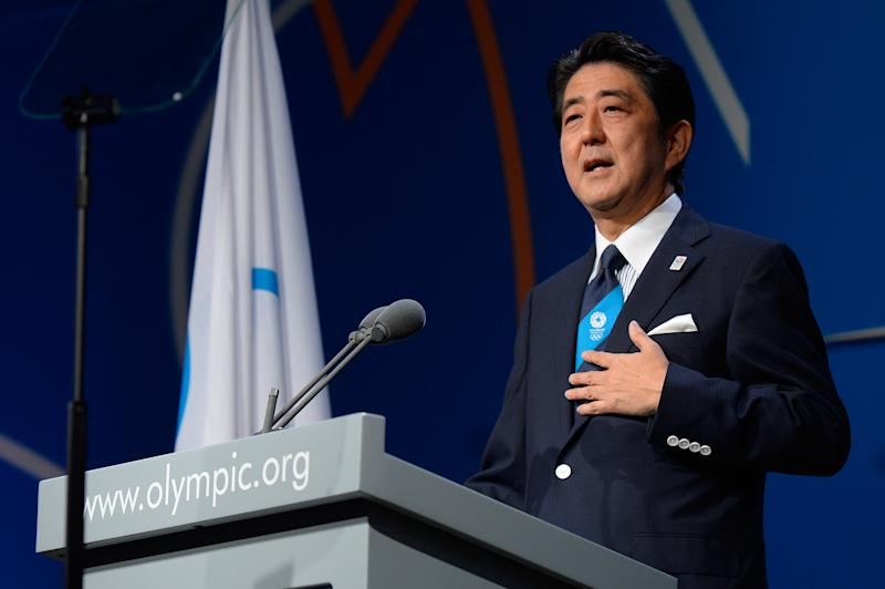Japan's Prime Minister Shinzo Abe, addresses the International Olympic Committee session during the Tokyo 2020 bid presentation in Buenos Aires, Argentina, Saturday, Sept. 7, 2013. (AP Photo/Fabrice Coffrini, Pool)