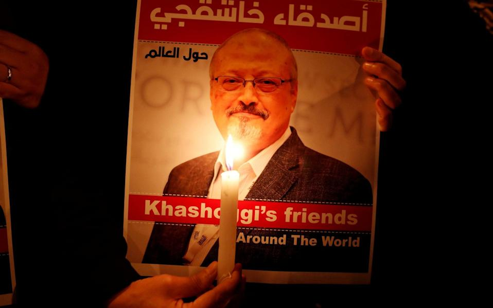 A demonstrator holds a poster with a picture of Saudi journalist Jamal Khashoggi outside the Saudi Arabia consulate in Istanbul - Reuters