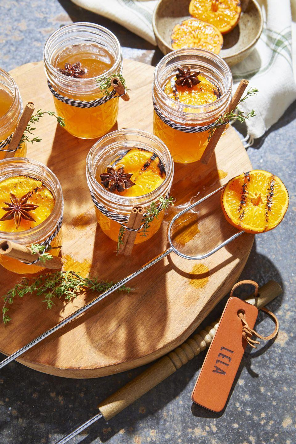 """<p>Honey is a staple part of any hot toddy. In this elevated version, fall spices add lots of depth.</p><p><strong><a href=""""https://www.countryliving.com/food-drinks/a34945104/hot-toddy-with-charred-oranges-recipe/"""" rel=""""nofollow noopener"""" target=""""_blank"""" data-ylk=""""slk:Get the recipe"""" class=""""link rapid-noclick-resp"""">Get the recipe</a>.</strong></p>"""