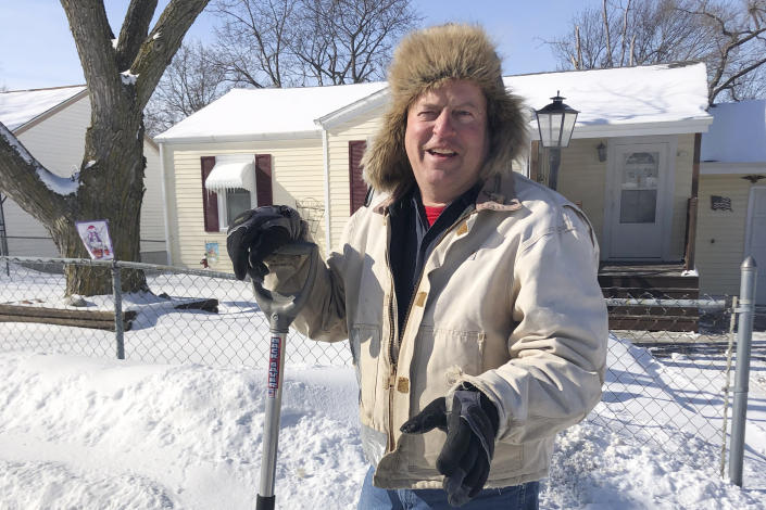 """Tracy Fackler pauses from clearing the sidewalk in front of his home, Tuesday, Feb. 9, 2021, in Omaha, Neb. The 63-year-old auto mechanic praises Nebraska Republican Sen. Ben Sasse for condemning former President Donald Trump's actions before the Jan. 6 Capitol riot. """"I'd rather have him say what he's seeing and what he's thinking,"""" Fackler said. (AP Photo/Tom Beaumont)"""
