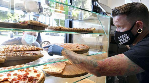 PHOTO: Owner Ben Sales takes orders at Ghost Pizza on July 10, 2020 in Los Angeles. (Rodin Eckenroth/Getty Images)