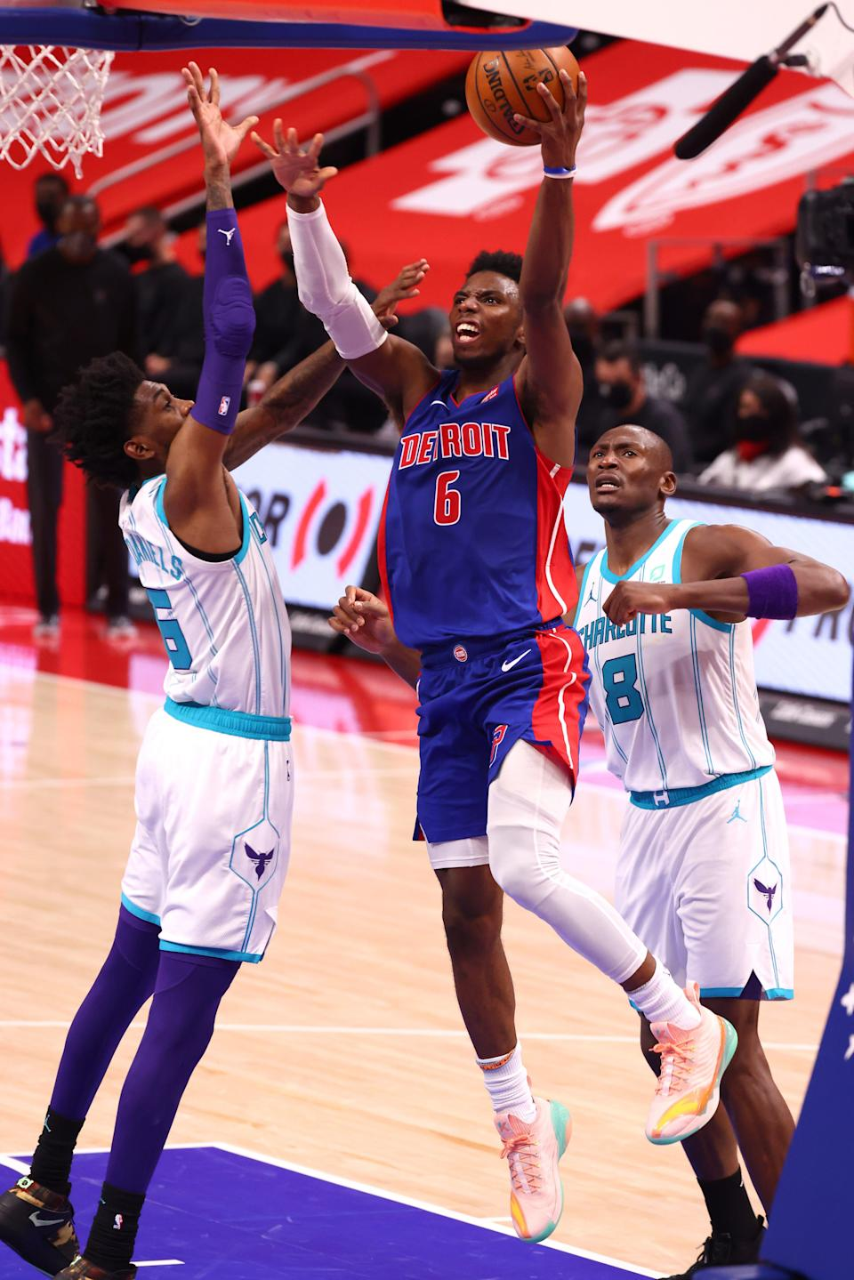 Hamidou Diallo of the Detroit Pistons drives to the basket past Jalen McDaniels of the Charlotte Hornets during the second half at Little Caesars Arena in Detroit on Tuesday, May 4, 2021.