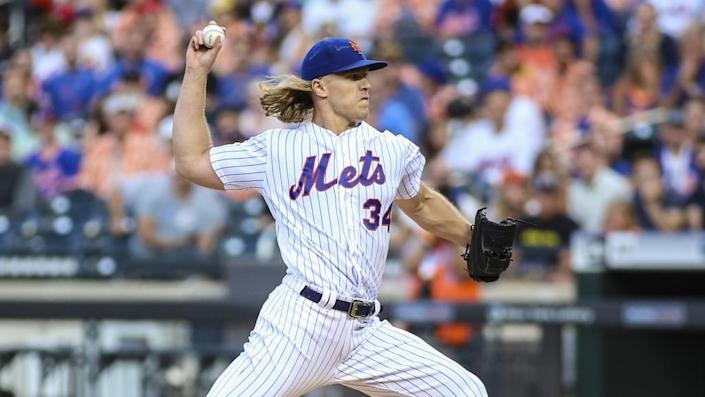 Aug 10, 2019; New York City, NY, USA; New York Mets pitcher Noah Syndergaard (34) pitches in the first inning against the Washington Nationals at Citi Field. Mandatory Credit: Wendell Cruz-USA TODAY Sports