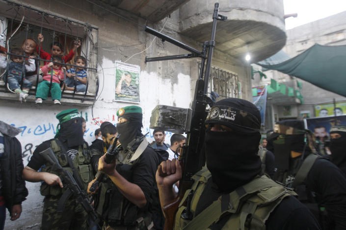 Hamas militants stand during a Hamas press conference in Gaza City, Thursday, Nov. 22, 2012. Gazans are celebrating a cease-fire agreement reached with Israel to end eight days of the fiercest fighting in nearly four years constricting the Gaza Strip. (AP Photo/Hatem Moussa)