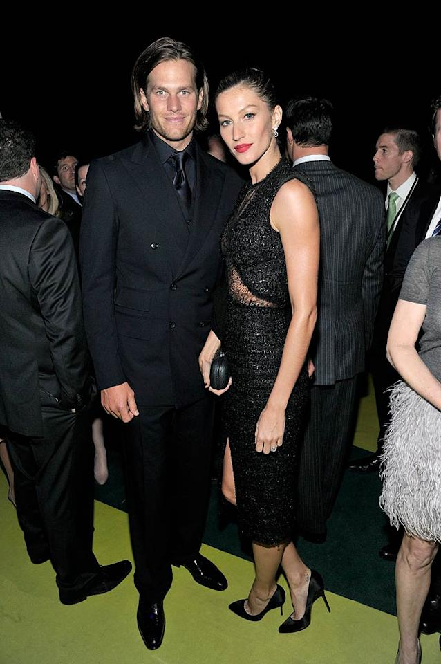 NFL star Tom Brady his wife, the world's highest paid supermodel Gisele Bundchen, coordinated their all-black ensembles when they attended the 2011 Robin Hood Foundation Gala at New York's Jacob Javits Convention Center. Evan Agostini/PictureGroup - May 9, 2011