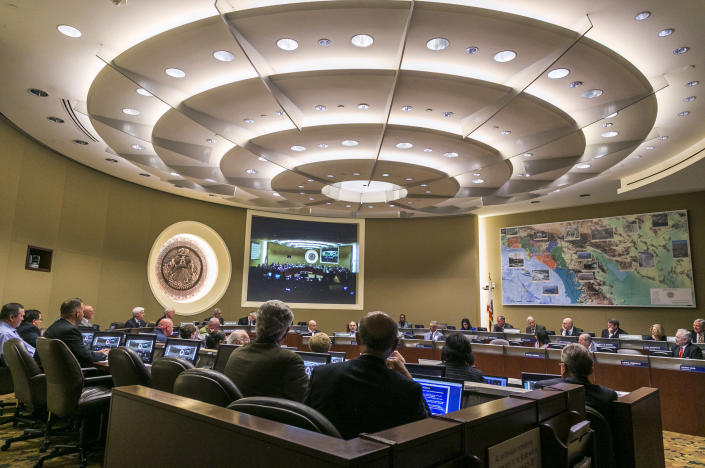 FILE - In this Monday, April 13, 2015, file photo, members of the board committee of the Metropolitan Water District, MWD moved forwards on a proposal that would cut regional water deliveries by 15 percent beginning this summer, during a meeting in Los Angeles. A major Southern California water agency has declared a water supply alert for the first time in seven years, Tuesday, Aug. 17, 2021 and is asking residents to voluntarily conserve. (AP Photo/Damian Dovarganes)