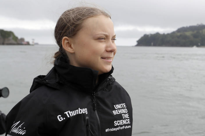 Climate change activist Greta Thunberg arrives to board the Malizia II boat in Plymouth, England, Wednesday, Aug. 14, 2019. The 16-year-old climate change activist who has inspired student protests around the world will leave Plymouth, England, bound for New York in a high-tech but low-comfort sailboat.(AP Photo/Kirsty Wigglesworth, pool)