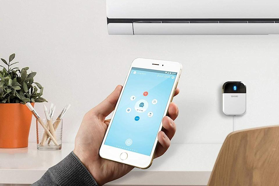 """<a href=""""https://amzn.to/3iAzKK7"""" target=""""_blank"""" rel=""""noopener noreferrer"""">The Sensibo Sky is a smart AC controller</a> that turns any air conditioner into a smart air conditioner. (Photo: Amazon)"""