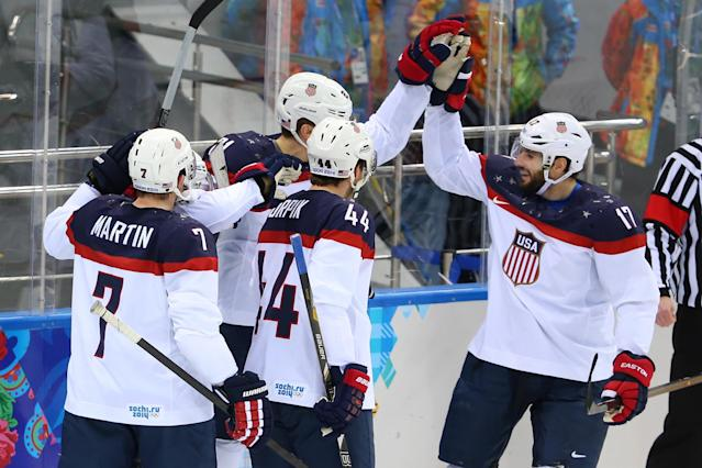 SOCHI, RUSSIA - FEBRUARY 19: James van Riemsdyk #21 of the United States celebrates with his teammates after scoring a goal in the first period against Ondrej Pavelec #31 of the Czech Republic during the Men's Ice Hockey Quarterfinal Playoff on Day 12 of the 2014 Sochi Winter Olympics at Shayba Arena on February 19, 2014 in Sochi, Russia. (Photo by Quinn Rooney/Getty Images)