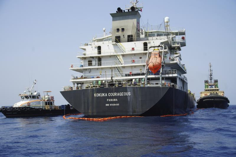 """The damaged Panama-flagged, Japanese owned oil tanker Kokuka Courageous is anchored off Fujairah, United Arab Emirates, Wednesday, June 19, 2019. The limpet mines used to attack the oil tanker near the Strait of Hormuz bore """"a striking resemblance"""" to similar mines displayed by Iran, a U.S. Navy explosives expert said Wednesday. Iran has denied being involved. (AP Photo/Fay Abuelgasim)"""