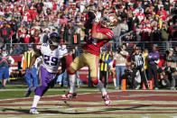 San Francisco 49ers wide receiver Kendrick Bourne, right, catches a pass for a touchdown in front of Minnesota Vikings cornerback Xavier Rhodes (29) during the first half of an NFL divisional playoff football game, Saturday, Jan. 11, 2020, in Santa Clara, Calif. (AP Photo/Tony Avelar)