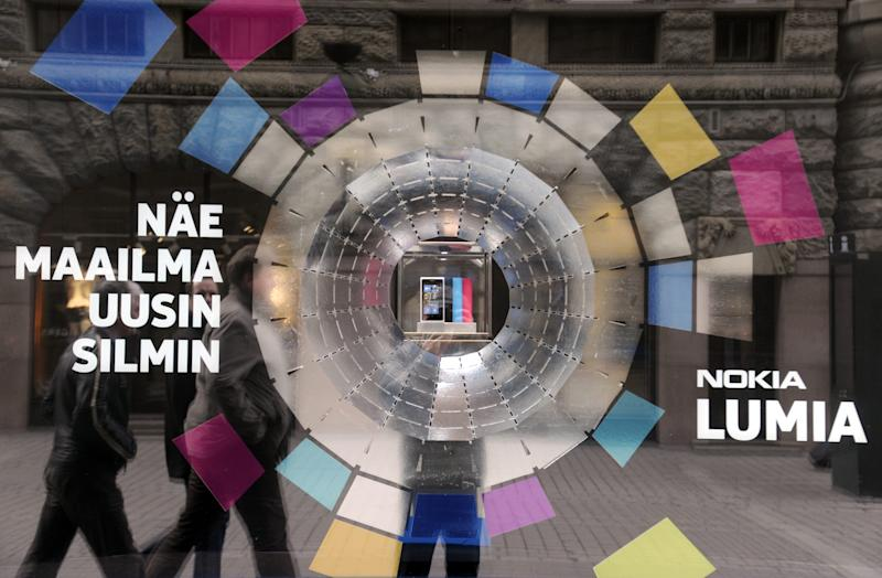 The window of Nokia's flagship store  displays an advertisement of the new Nokia Lumia mobile phone in Helsinki on Thursday, April, 19, 2012 .  Mobile phone manufacturer Nokia published its weak first quarter 2012 results on Thursday.  (AP Photo/LEHTIKUVA / Markku Ulander) FINLAND OUT