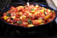 """<p>Have leftover <a href=""""https://www.thedailymeal.com/eat/summer-produce-guide?referrer=yahoo&category=beauty_food&include_utm=1&utm_medium=referral&utm_source=yahoo&utm_campaign=feed"""" rel=""""nofollow noopener"""" target=""""_blank"""" data-ylk=""""slk:summer produce"""" class=""""link rapid-noclick-resp"""">summer produce</a> in your garden you don't want to waste? Put it together and make a classic ratatouille for a healthy, vegetarian-friendly meal that's as beautiful as it is flavorful.</p> <p><a href=""""https://www.thedailymeal.com/recipes/ratatouille?referrer=yahoo&category=beauty_food&include_utm=1&utm_medium=referral&utm_source=yahoo&utm_campaign=feed"""" rel=""""nofollow noopener"""" target=""""_blank"""" data-ylk=""""slk:For the Ratatouille recipe, click here."""" class=""""link rapid-noclick-resp"""">For the Ratatouille recipe, click here.</a></p>"""
