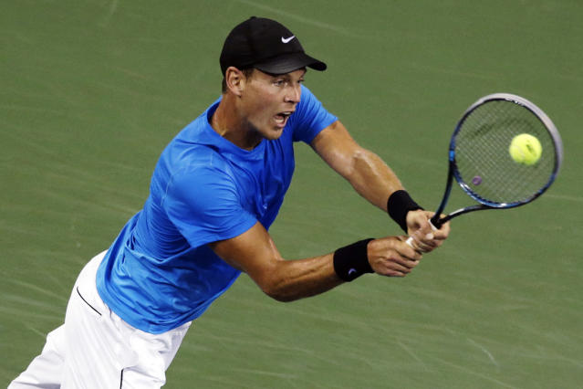 Tomas Berdych, of the Czech Republic, returns to Roger Federer, of Switzerland, in the quarterfinal round of play at the U.S. Open tennis tournament, Wednesday, Sept. 5, 2012, in New York. (AP Photo/Charles Krupa)