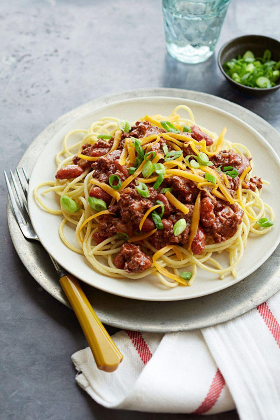 "<p>Give your spread a little Midwestern flair by serving your chili over a bowl of spaghetti, two-way style!</p><p><a href=""https://www.goodhousekeeping.com/food-recipes/a12104/cincinnati-chili-recipe-ghk0114/"" rel=""nofollow noopener"" target=""_blank"" data-ylk=""slk:Get the recipe for Cincinnati Chili »"" class=""link rapid-noclick-resp""><em>Get the recipe for Cincinnati Chili »</em></a></p>"