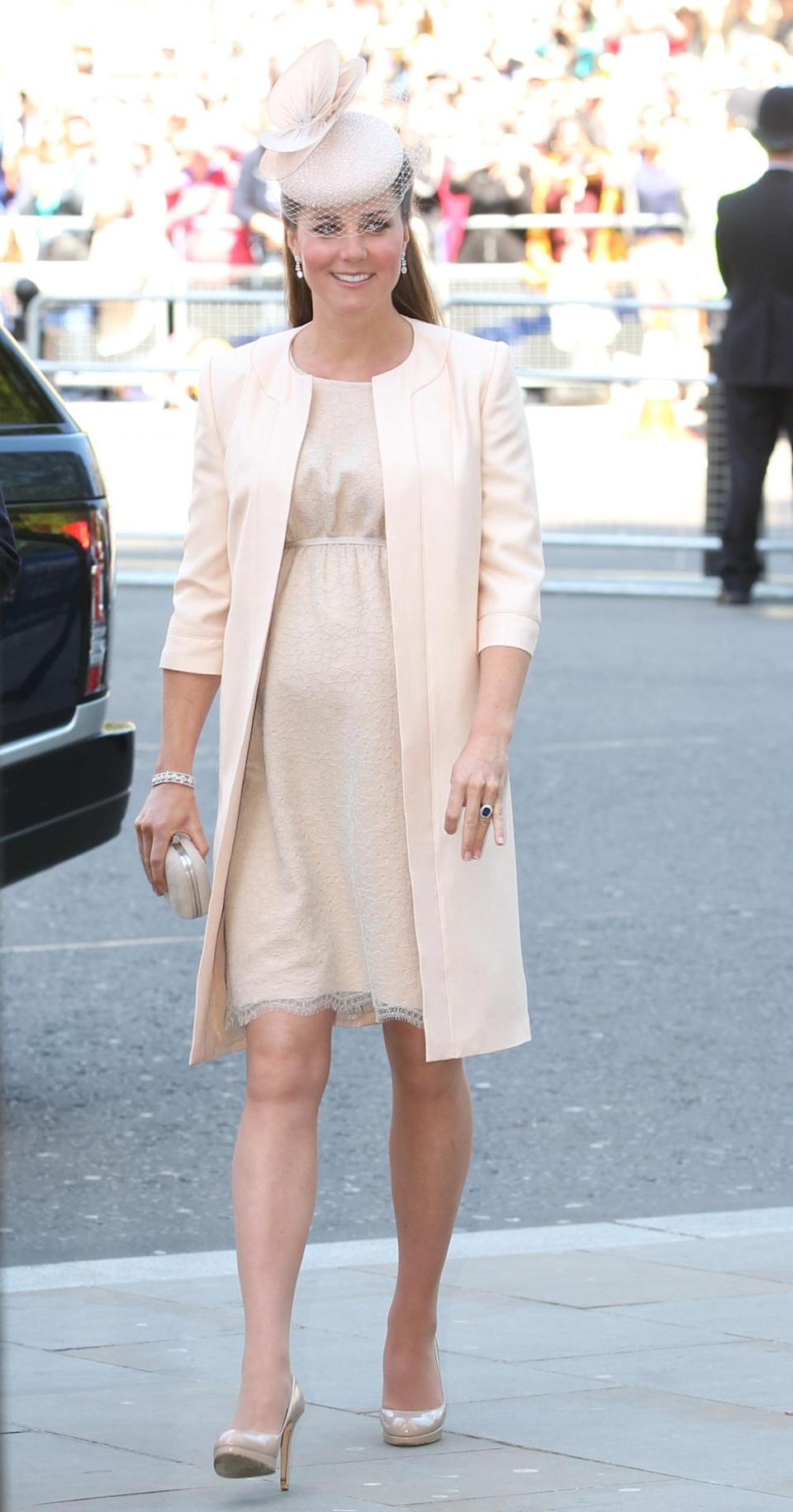 <p>The Duchess arrived at Westminster Abbey for the 60th anniversary of the Queen's coronation in a pink lace dress by her go-to event designer, Jenny Packham. She accessorised with a suede grey Alexander McQueen clutch, a netted Jane Taylor hat and nude L.K. Bennett pumps. </p><p><i>[Photo: PA]</i></p>