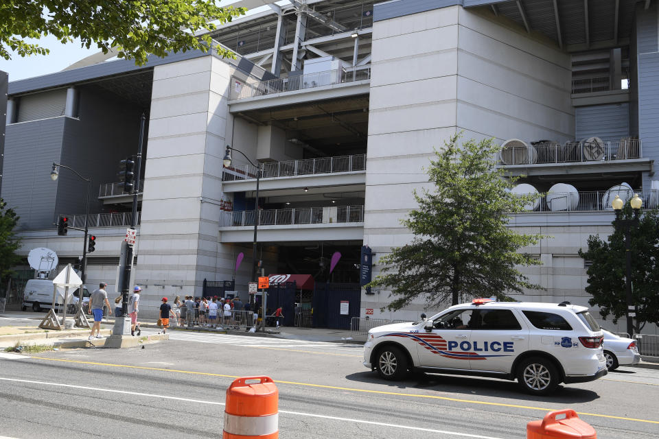 A police vehicle is seen across from Nationals Park, Sunday, July 18, 2021, in Washington. A baseball game between the San Diego Padres and Washington was suspended in the sixth inning Saturday night after a shooting outside Nationals Park. (AP Photo/Nick Wass)
