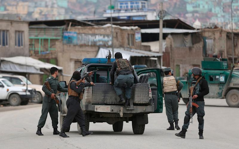 Afghan personnel arrive at the site of an attack in Kabul - AP