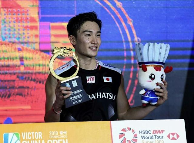 Japan's Kento Momota celebrates with the trophy after winning the China Open men's singles final in 2019 in Changzhou (AFP Photo/STR)
