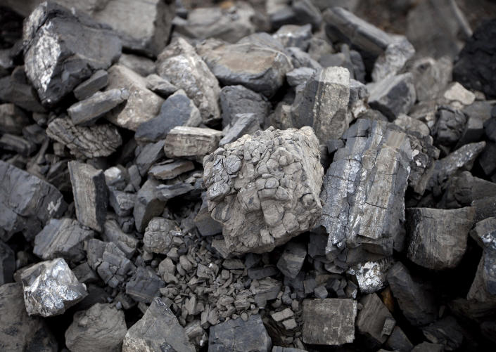 In this July 6, 2012 photo, pieces of coal lay in a pile at the Erdenes Tavan Tolgoi, a coal mining company in Tavan Tolgoi, southern Mongolia. Chinese demand for copper and especially coal has propelled the Mongolian economy to one of the world's fastest growing, making some wealthy and driving down poverty in a still poor country, and China wants a larger share of the resources. (AP Photo/Andy Wong)