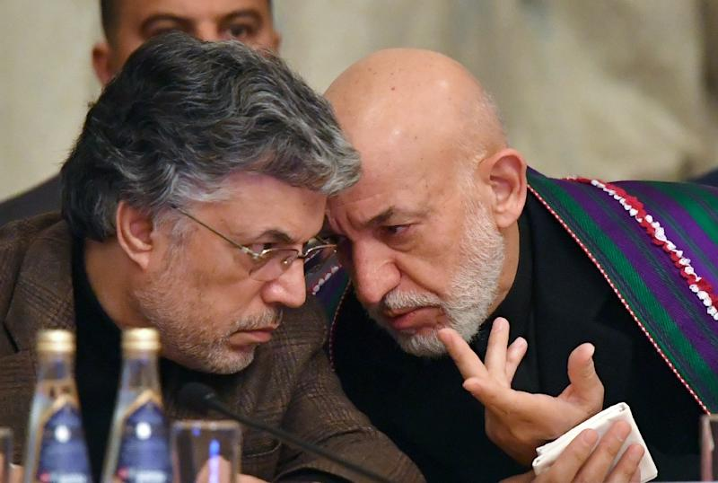 Former Afghan president Hamid Karzai (R) is set to attend this week's meeting in Moscow