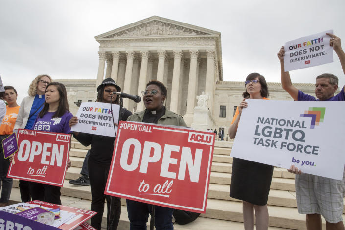 "<span class=""s1"">Naomi Washington-Leapheart, the faith work director for the National LGBTQ Task Force, addresses activists in front of the Supreme Court on Monday. (Photo: J. Scott Applewhite/AP)</span>"