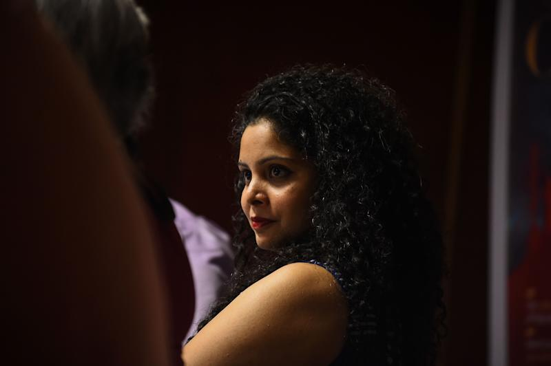 In this photograph taken on May 27, 2016, Indian journalist and author, Rana Ayyub looks on during the launch of her self published book 'Gujarat Files' in New Delhi. / AFP / CHANDAN KHANNA (Photo credit should read CHANDAN KHANNA/AFP via Getty Images)