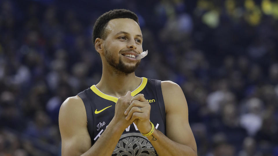 Steph Curry responded to a young fan who wanted to know why his Under Armour sneakers don't come in sizes for girls. (AP Photo/Jeff Chiu)