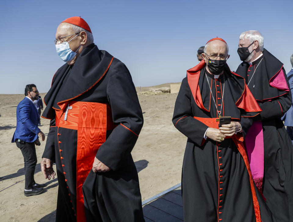 From left, Prefect of the Congregation for the Oriental Churches Cardinal Leonardo Sandri, Grand Master of the Equestrian Order of the Holy Sepulchre of Jerusalem Cardinal Fernando Filoni, and Vatican's Secretary (Relations with States) of the Secretariat of State Archbishop Paul Gallagher arrive ahead of an inter religious meeting with Pope Francis near the archaeological area of the Sumerian city-state of Ur, 20 kilometers south-west of Nasiriyah, Iraq, Saturday, March 6, 2021. Ur is considered the traditional birthplace of Abraham, the prophet common to Muslims, Christians and Jews. Earlier today Francis met privately with the country's revered Shiite leader, Grand Ayatollah Ali al-Sistani. (AP Photo/Andrew Medichini)