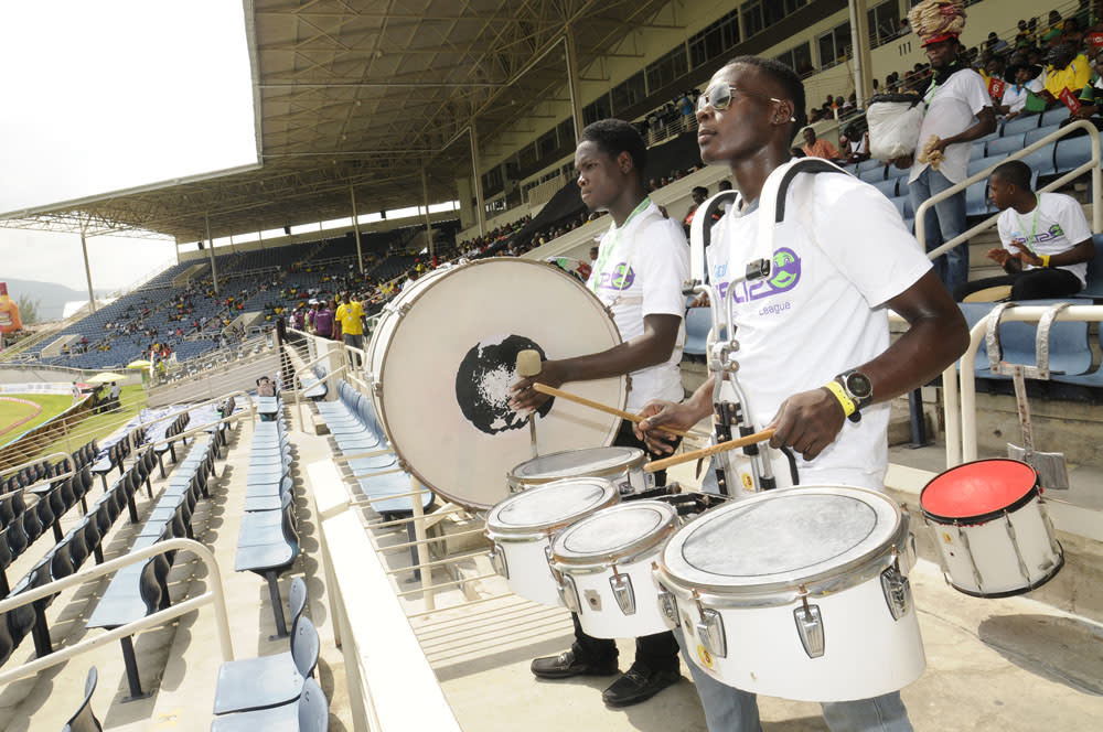 KINGSTON, JAMAICA - AUGUST 17: Fans cheer their team during the Eighteenth Match of the Cricket Caribbean Premier League between St. Lucia Zouks v Trinidad and Tobago Red Steel at Sabina Park on August 17, 2013 in Kingston, Jamaica. (Photo by Taylor Gladstone/Getty Images Latin America for CPL)